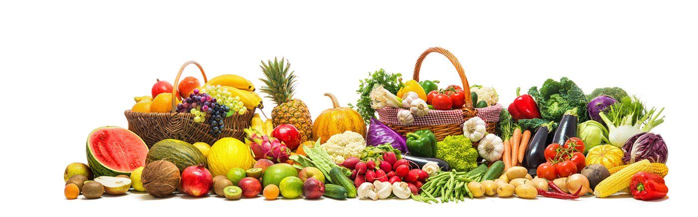 Eine Vielzahl Obst und gemüse Auf einem weißen Tisch drapiert